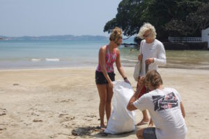 cleaning Weligama beach