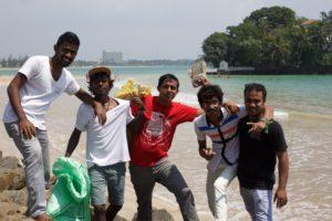 The Ceylon Sliders team picking up rubbish