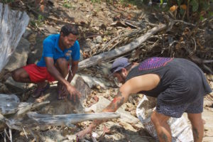 Locals and travellers at Weligama beach clean